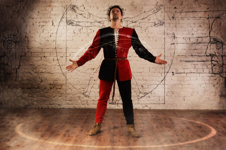 Man in medieval suit performing magic moment Stock Photo - 22810302