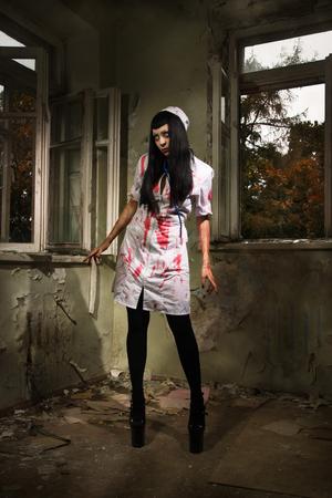 Crazy dead nurse in an abandoned hospital photo