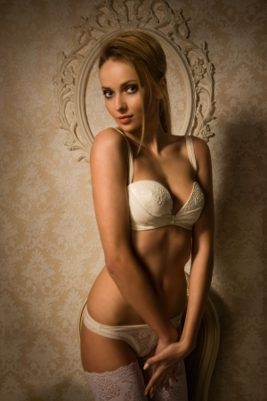 Beautiful blonde woman in a luxurious lingerie  photo