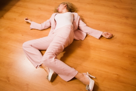 strangulation: Crime scene simulation: unconscious business woman lying on the floor Stock Photo