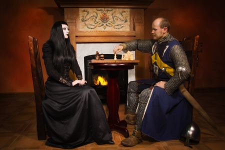 Medieval knight plays chess with death       photo