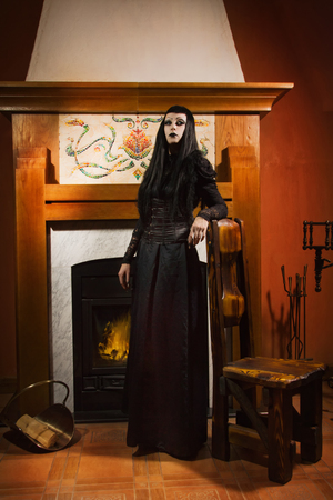 Gothic woman in medieval castle photo