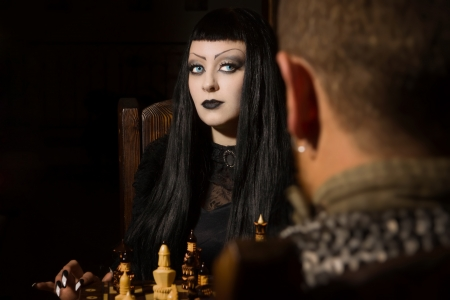 Death plays chess in a castle photo