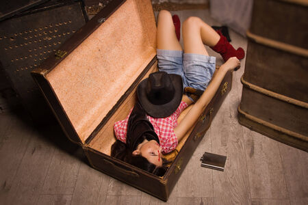 Crime scene in a western style. Lifeless sheriff woman  photo