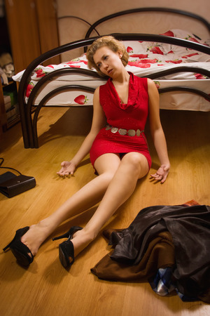 Scene of the crime: the victim of an armed robbery on the floor Stock Photo
