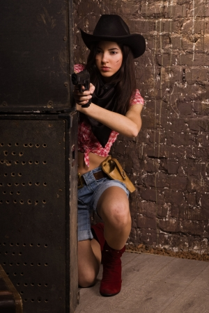 suffocate: Girl cowboy shoots from a revolver