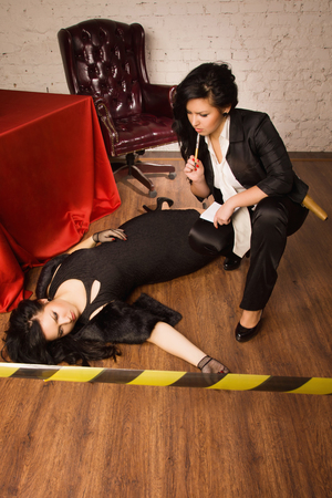 business crime: Retro girl detective  collecting evidence at a crime scene