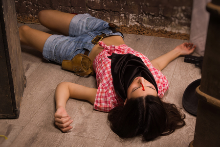 Crime scene in a western style. Lifeless sheriff woman lying on the floor