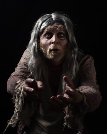 hobo: Hobo. Emotional portrait of the gray-haired tramp