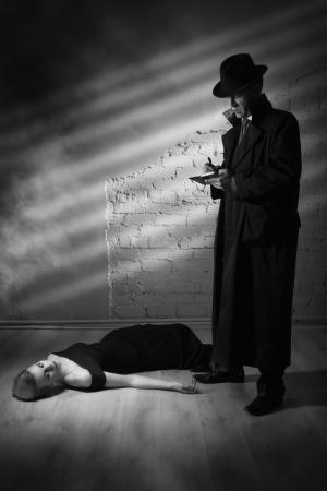 organized crime: Film noir. Detective investigating the crime scene Stock Photo