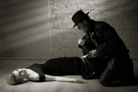 noir: Film noir. Detective investigating the crime scene Stock Photo