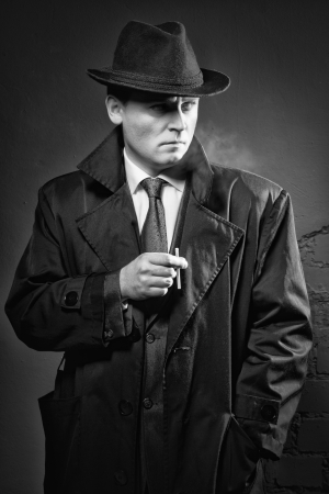 Film noir. Retro styled fashion portrait of a detective photo