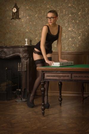 Spy girl opens a secret briefcase Banco de Imagens