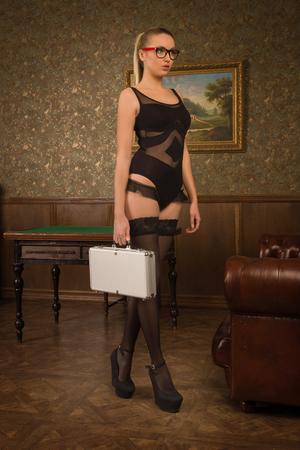spy girl: Spy girl with a metal briefcase Stock Photo