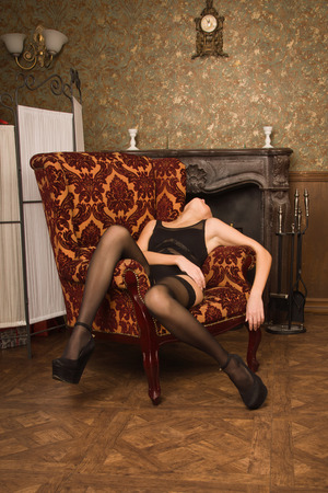 Crime scene simulation. Lifeless woman in a luxurious lingerie  photo