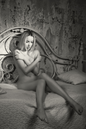 Gorgeous nude blonde lying on the bed photo