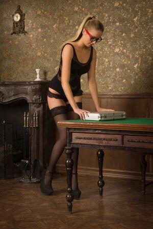 spy girl: Spy girl opens a secret briefcase Stock Photo