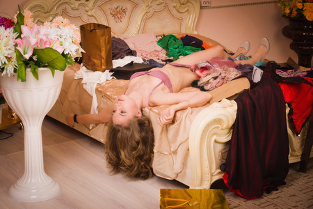 Crime scene simulation. Lifeless woman in a luxurious lingerie lying on the bed photo