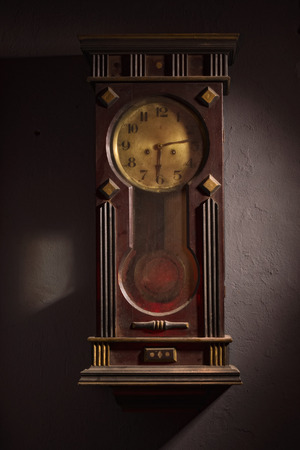 Wall Hanging Grandfather Clock old wooden grandfather clock hanging on a wall stock photo