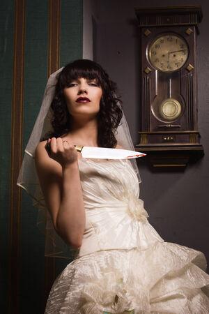 Bride holding sharp knife photo