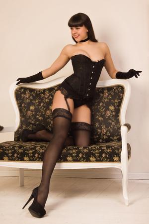 Attractive pin-up girl wearing black underwear photo