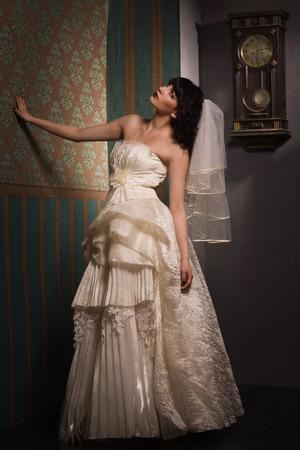 dark interior: Gothic bride in the dark interior Stock Photo