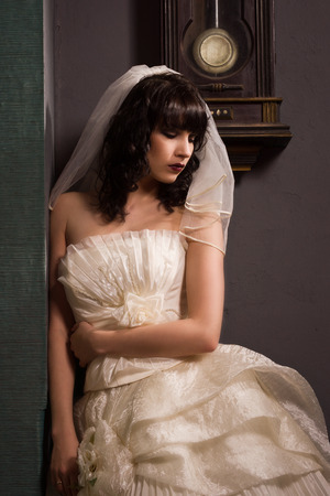 Gothic bride in the dark interior photo