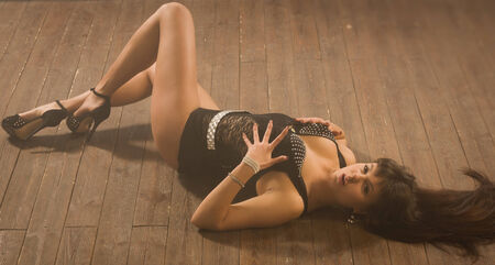 Sexy young woman in a dancing suit GO-GO lying on the floor photo