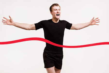 finish line: portrait of a runner at the finish line isolated on white background Stock Photo