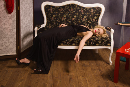 Crime scene simulation. Lifeless woman in a luxurious interior photo