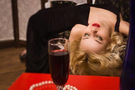 Crime scene simulation. Lifeless woman in a luxurious interior photo