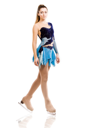 Figure skater posing in skating performance costume photo