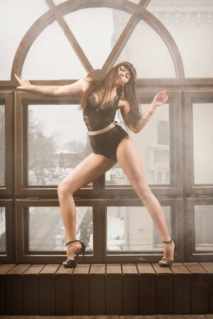 Sexy young woman with long legs in a dancing suit GO-GO  photo