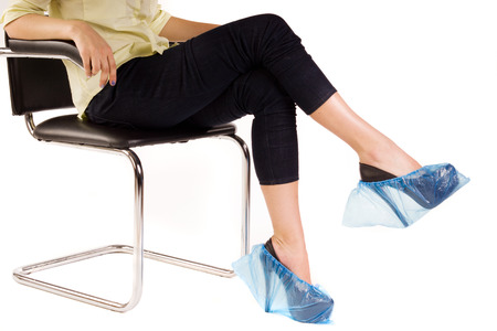 sterilized: Female legs in overshoes over white Stock Photo