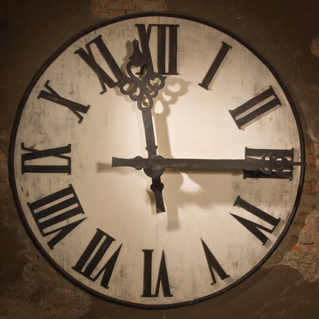 grandfather clock: Old large clock face hanging on a wall