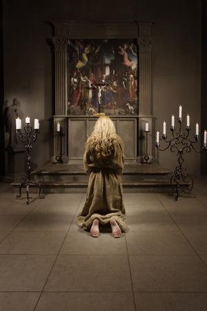 sinner: Sinner prays in medieval church