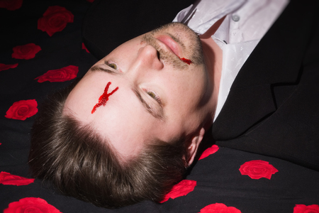 swooned: Corpse of business man lays on a bed Stock Photo