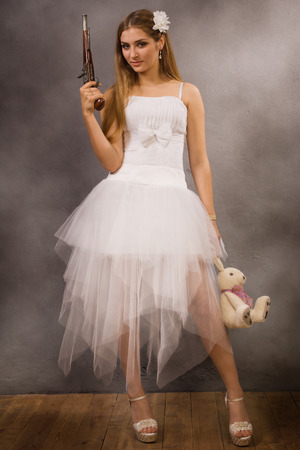 bride with a pistol in his hand photo