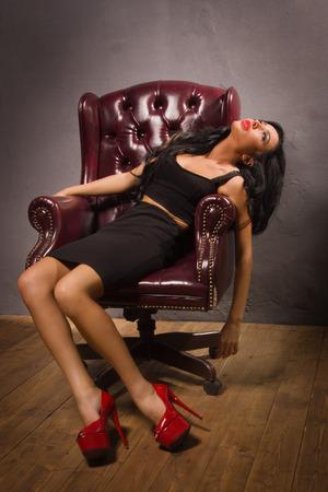 Crime scene simulation. Sensual unconscious woman photo