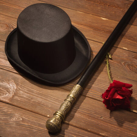 hat, cane and rose on a wooden floor  photo