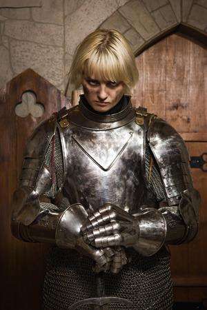 Joan of Arc. Girl in a knight's armor in the interior of a medieval castle Reklamní fotografie - 32212510