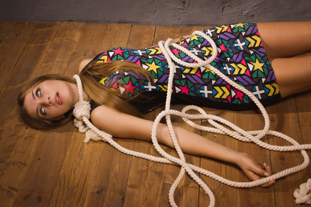 hanged: Suicide simulation. Young caucasian hanged woman Stock Photo