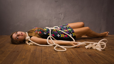 hanged woman: Suicide simulation. Young caucasian hanged woman Stock Photo