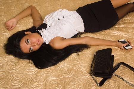 Crime scene simulation. Strangled victim in a luxury bedroom photo