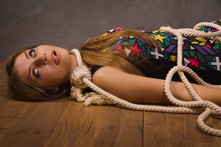 Suicide simulation. Young caucasian hanged woman photo