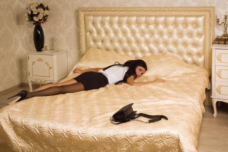 strangled: Crime scene simulation. Strangled victim in a luxury bedroom