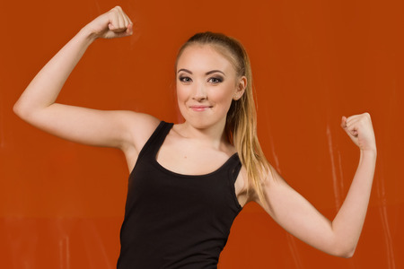 Young sports woman in gym photo