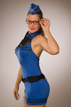 stewardess: Portrait of sexual stewardess over grey background Stock Photo