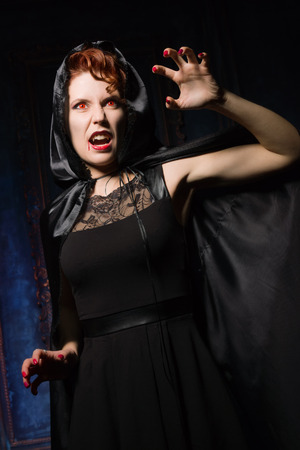 demoniacal: Angry woman vamp in the dark interior