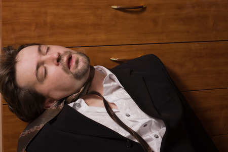 swooned: Corpse of strangled business man